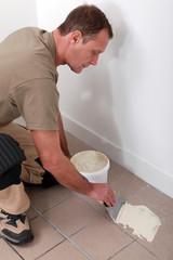 Man preparing to retile a floor