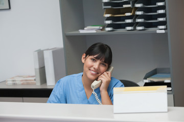 Nurse smiling while phoning