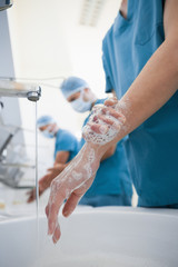 Hospital surgeon washing hands