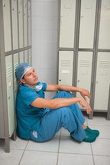 Surgeon sitting in a locker room