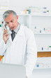 Pharmacist on the phone in a pharmacy