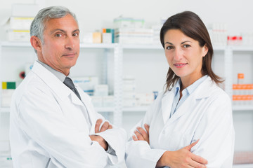 Two pharmacists with their arms crossed