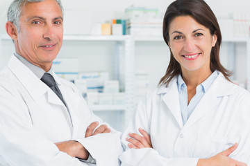 Smiling pharmacists with their arms folded