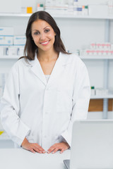 Pharmacist standing behind the counter of a pharmacist