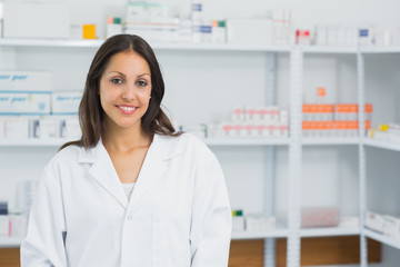 Smiling pharmacist in a pharmacy