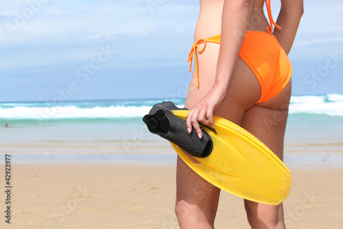 Woman on the beach with flippers