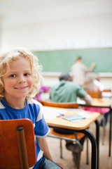 Elementary school student not paying attention to teacher