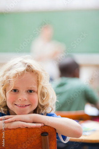 Schoolboy not paying attention to teacher