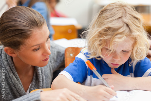 Teacher assisting one of her students