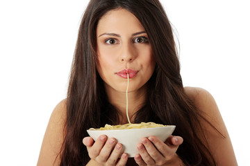 Beautiful woman is eating pasta.