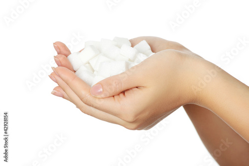 Woman's hands full of sugar cubes.