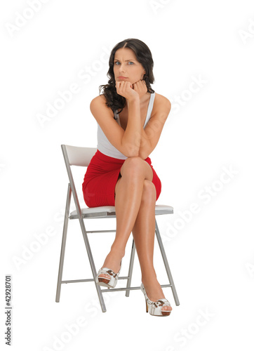 pensive woman on a chair