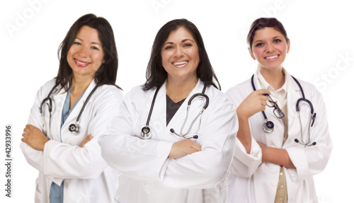 Three Hispanic Female Doctors or Nurses on White