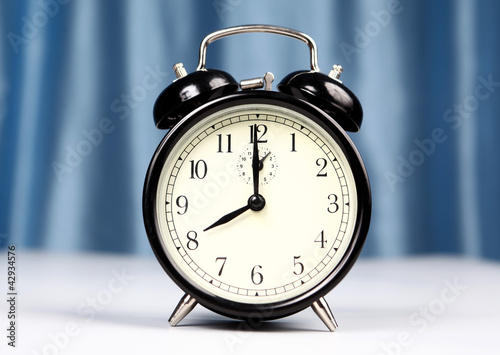 Alarm clock on a light background