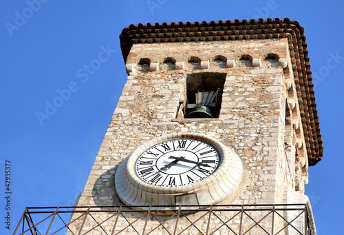Bell tower of Church Notre Dame clock Cannes France