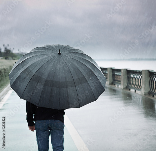 rain and lonely man with umbrella