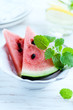 Sliced water melon with lemon mint in a bowl