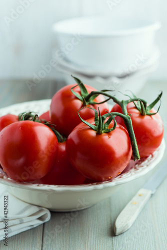 Tomatoes on the vine in a bowl