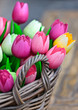 Colorful wooden tulips in a basket