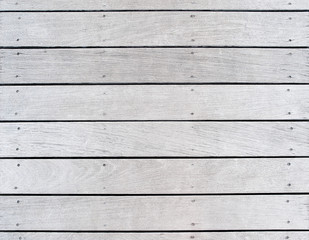 A boat dock's old, weathered and faded wood decking