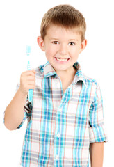 funny little boy with toothbrush isolated on white