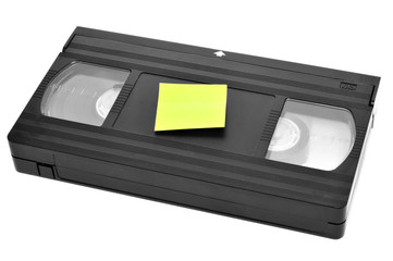 videotape with blank sticky note