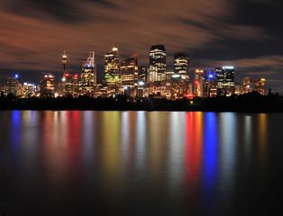 sydney city skyline reflections on water, australia