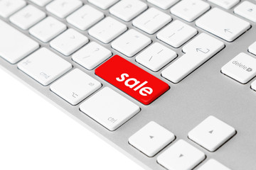 "Computer keyboard with red ""sale"" button"
