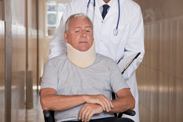 Doctor with Patient in Wheelchair