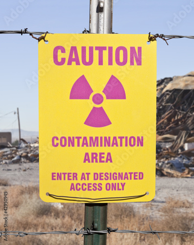 Caution Contamination Area Sign with Ruin Backdrop