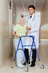 Doctor Assisting An Old Woman With Her Walker