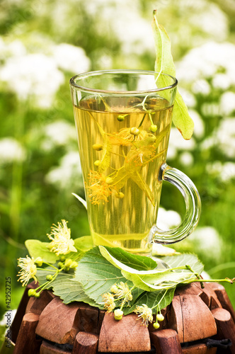 cup of linden tea and flowers