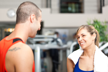Man and girl talking at the fitness club
