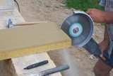 bricklayer builds a wall, rebar cutting angle grinder poster