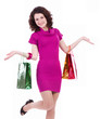 Happy young woman with shopping bags isolated