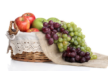 Basket full of apples and juicy grapes