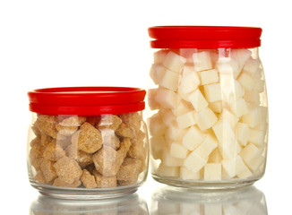 Jars with brown cane sugar lump and white lump sugar isolated
