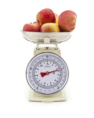 Old style kitchen scales with Apples on white background Isolate