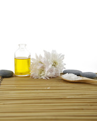Chrysanthemum with bath salt spoon in for aromatherapy on mat