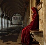 Woman in red cloak praying alone poster