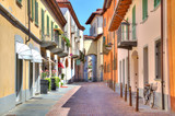 Fototapety Old colorful street in Alba, Northern Italy.