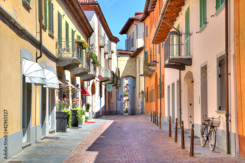Old colorful street in Alba, Northern Italy.