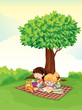 a boy and girl studying under tree.