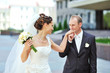 Groom kissing bride's hand while walking together
