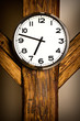wall clock hanging on wooden construction