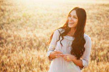 Beautiful lady in wheat field