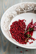 Bowl of pink peppercorns and dry chili peppers