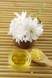 White Chrysanthemum with bath salt for aromatherapy on mat