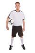 Fußballer mit Fußball und Fußballtrikot und Hose