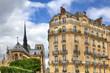 Parisian building and Notre Dame de Paris.
